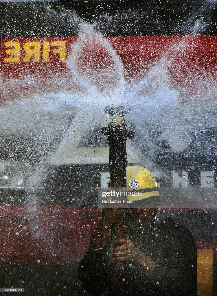 Delhi Fire Service personnel demonstrate their skills to observe Fire Service week on April 13, 2012 in New Delhi, India. The Fire department is observing Fire Week from April 14-20 during which a series of lectures and demonstrations on fire safety and awareness will be held at different venues across the city, including schools and hospitals.