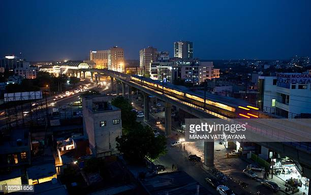 Delhi Metro Rail passes through Gurgaon around 30 km south of New Delhi on June 21 2010 New Delhi's metro train system which residents and tourists...