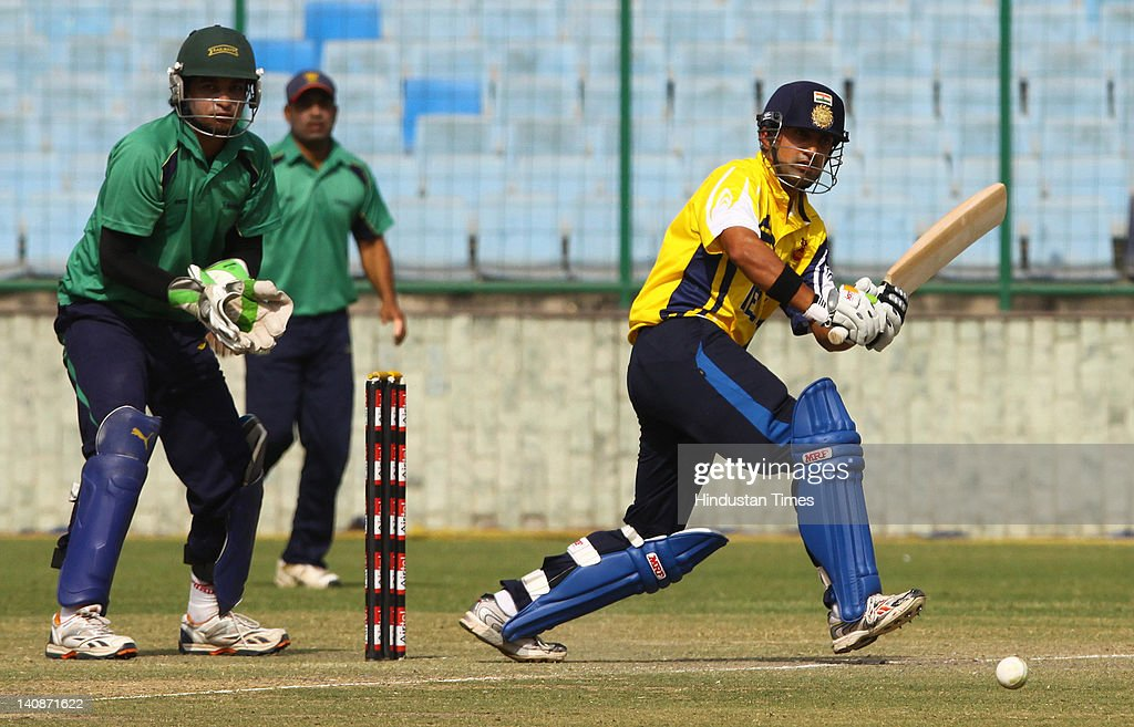 Delhi player <a gi-track='captionPersonalityLinkClicked' href=/galleries/search?phrase=Gautam+Gambhir&family=editorial&specificpeople=707703 ng-click='$event.stopPropagation()'>Gautam Gambhir</a> plays a shot during the Vijay Hazare Trophy quarter final match between Delhi and Railways at Ferozshah Kotla on March 7, 2012 in New Delhi, India. After getting Railways all out cheaply at 175, Delhi batmen make short of the total in just 37.4 overs.