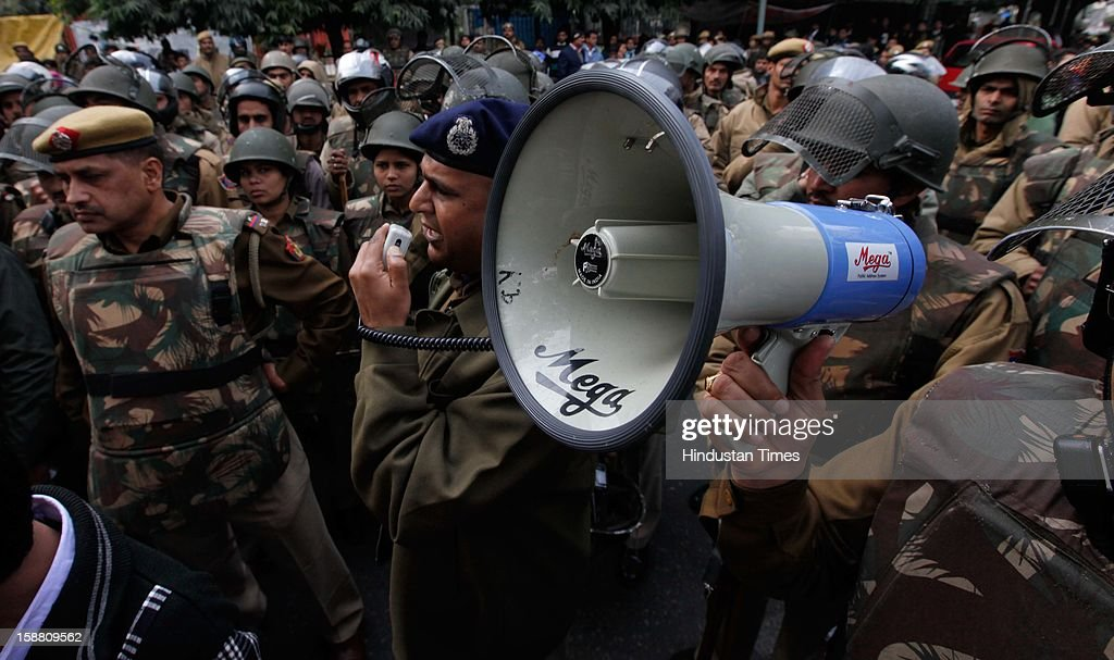 Delhi Police alert to demonstrators during a protest after the death of Delhi rape victim on December 30, 2012 in New Delhi, India. The young woman was cremated promptly on Sunday amid an outpouring of anger and grief by millions across the country demanding greater protection for women from sexual violence.