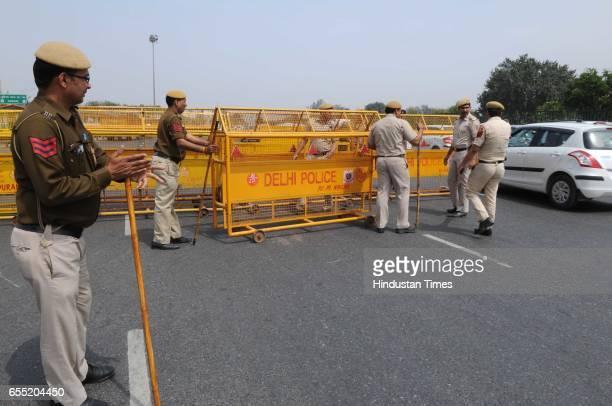 Delhi Police blocked the DelhiGurgaon Sarhaul border due to Jat agitation on March 19 2017 in Gurugram India The community is planning to hold...