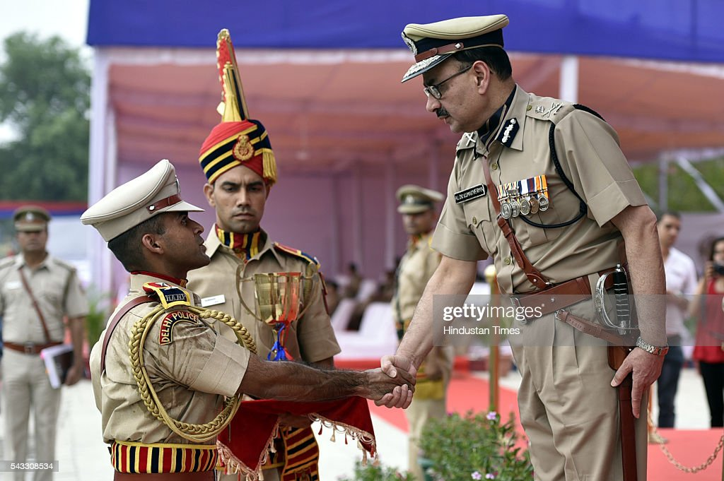 Delhi police Commissioner Alok Kumar Verma gives awards at Passing out Parade of 14th batch of Delhi, Andaman and Nicobar Islands Police Service at Jaroda Kalan, on June 27, 2016 in New Delhi, India.