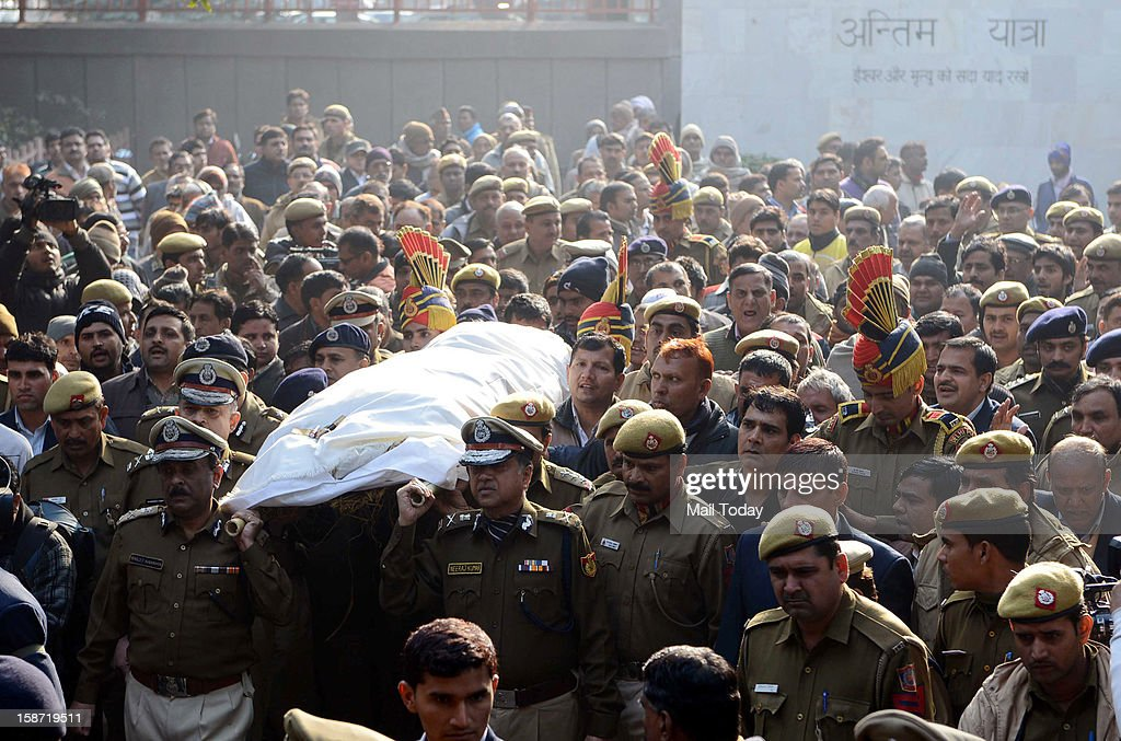 Delhi Police Commissioner Neeraj Kumar along with other senior police officers offering shoulders to the mortal remains of constable Subhash Chand Tomar during his cremation in New Delhi on Tuesday. Tomar died at a hospital on Tuesday after sustaining injuries during Sunday's massive protest against gangrape case.