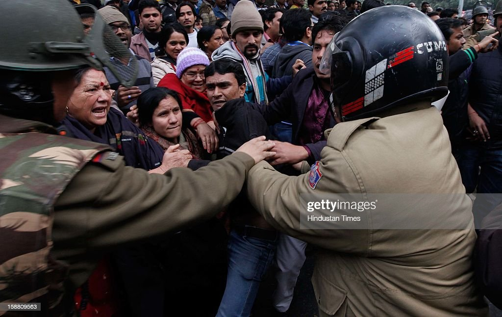 Delhi Police detain demonstrators during a protest after the death of Delhi rape victim on December 30, 2012 in New Delhi, India. The young woman was cremated promptly on Sunday amid an outpouring of anger and grief by millions across the country demanding greater protection for women from sexual violence.