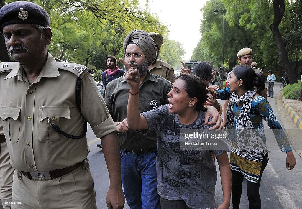 Delhi Police detaining supporters of Aam Aadmi Party outside Prime Minister's residence during a protest against the rape of a 5 year old girl and alleged police insensitivity in dealing with it on April 21, 2013 in New Delhi, India. A five year girl went missing on April 15 and was found on April 17 in same building where she lives with her parents in Gandhi Nagar. She was found in serious condition after being brutally raped and tortured with slashed neck and bite marks on her body. The man who lives in that room was arrested in Bihar state on April 20.