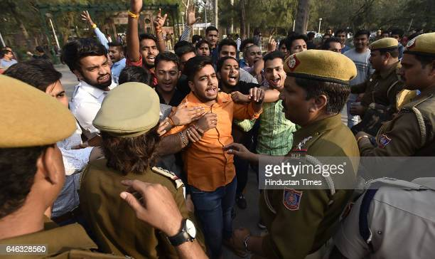Delhi Police disperse to ABVP students during the AISA JNUTA and Delhi University Students' protest march against ABVP wing after 22nd February issue...