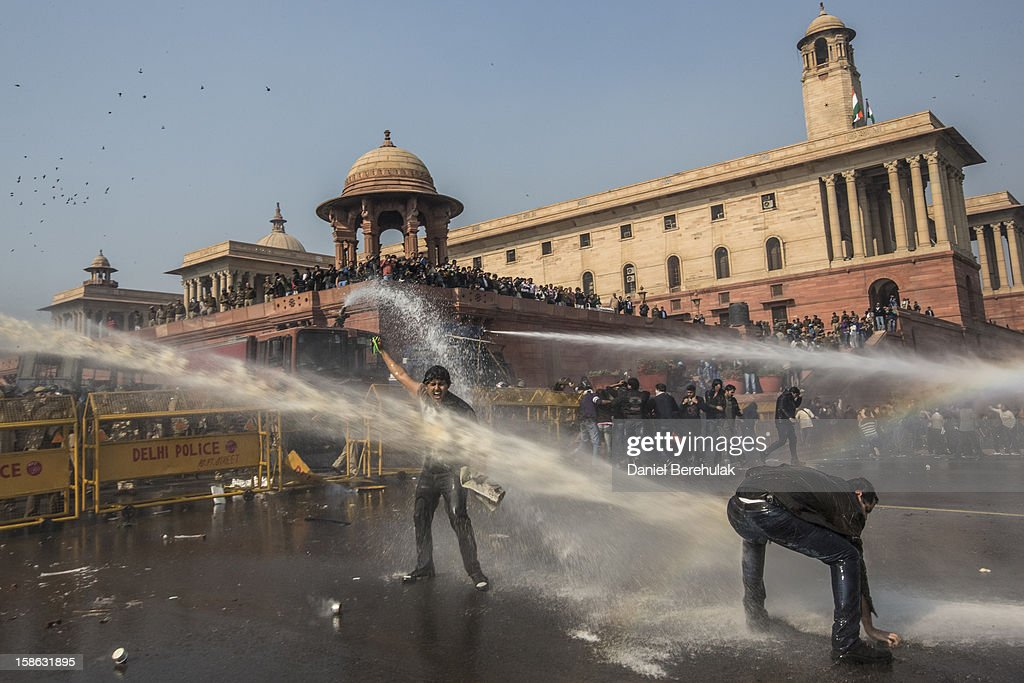 Delhi police fire water canons to disperse protestors during a protest against the Indian governments reaction to recent rape incidents in India in front of Rashtrapati Bhavan or the Presidential Palace on December 22, 2012 in New Delhi, India. Thousands of students gathered in front of the Presidential Palace in New Delhi to protest against current rape laws and the governments handling of recent rape cases all over India.