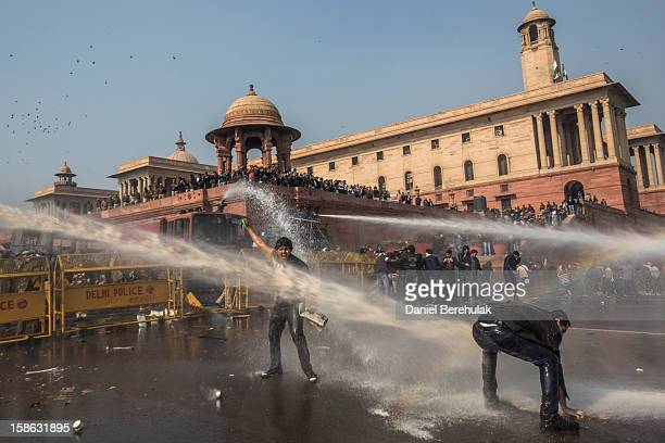 Delhi police fire water canons to disperse protestors during a protest against the Indian governments reaction to recent rape incidents in India in...