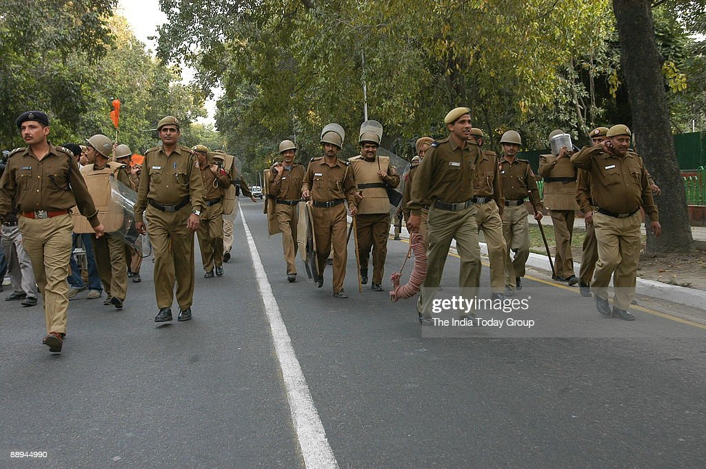 Delhi police marching during the demonstration by the supporters of the BJPYouth Wing to protest against the Shibu Soren former Chief Minister of...