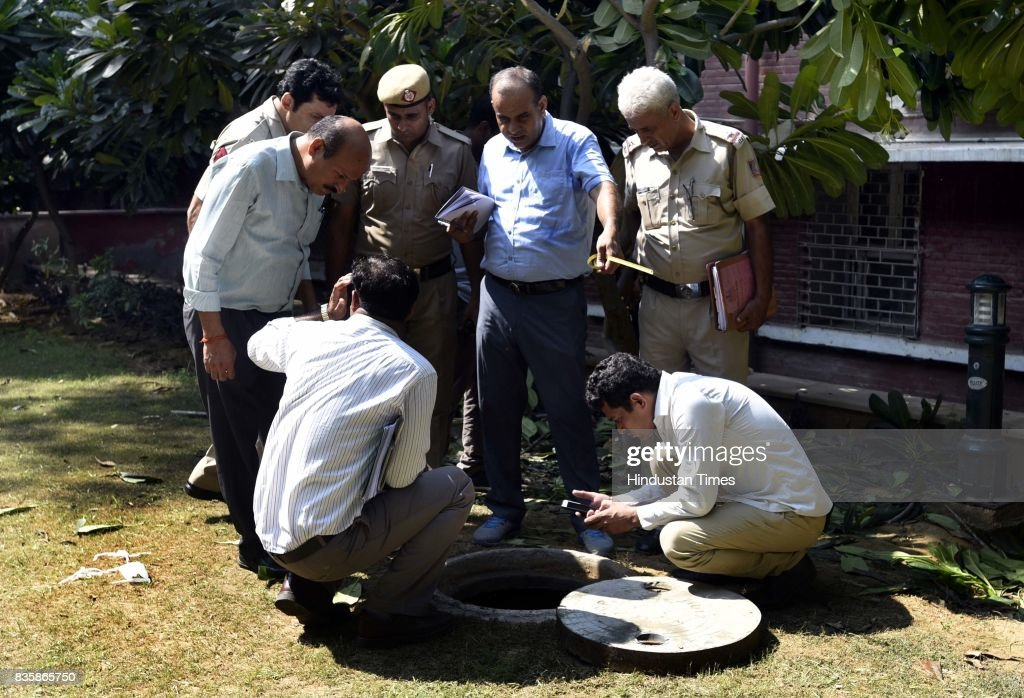 Delhi Police officers investigating the sewer where Rishi Pal was dead and left three people unconscious during sewer cleaning at Lok Nayak Jai Prakash Narayan Hospital, on August 20, 2017 in New Delhi, India. Rishi Pal, 40, along with Bishan, 30, Kiran Pal, 25, and Sumit, 30, fell unconscious after inhaling poisonous gases while cleaning the sewer.