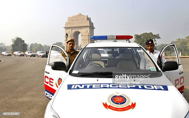 Delhi Police officers with their new interceptor vehicles after their flagging off at India Gate on December 17 2014 in New Delhi India To rein in...
