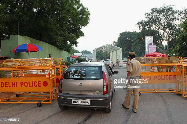 Delhi police patrol a venue entrance ahead of the Delhi 2010 Commonwealth Games which open this evening on October 3 2010 in Delhi India