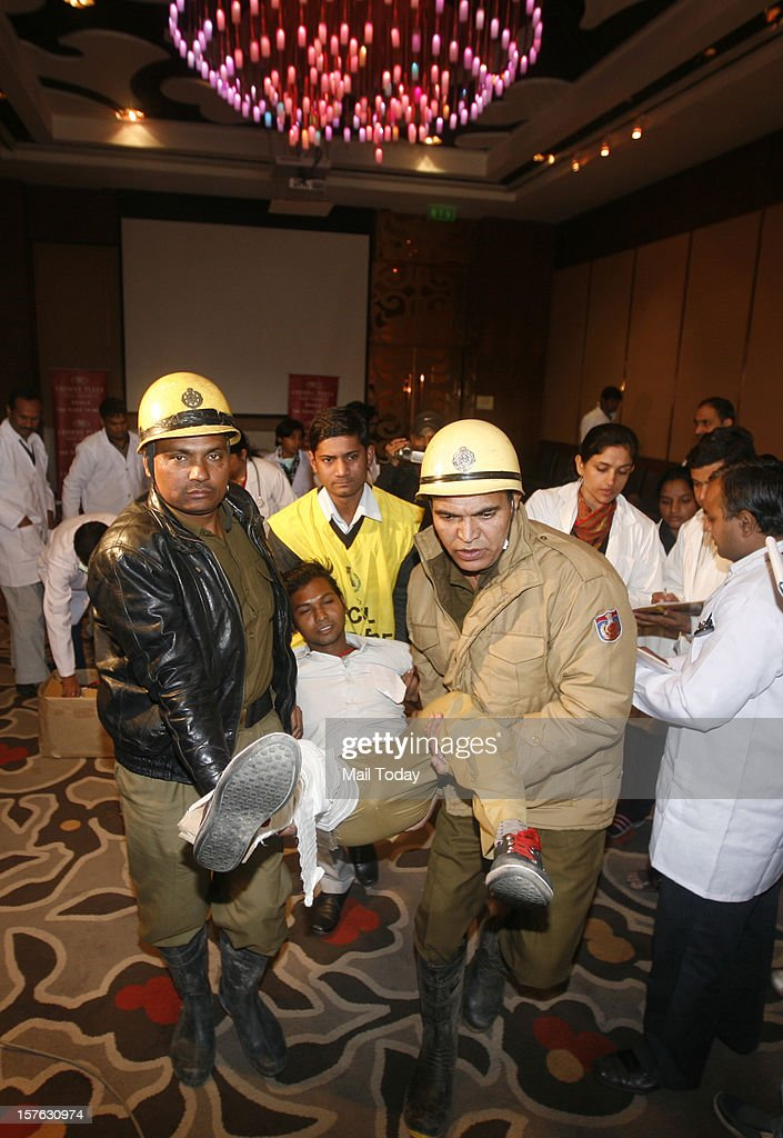 Delhi Police personnel and rescue team carrying injured persons (volunteers) to hospital during a mock security drill as part of Delhi Emergency Management Exercise (DEMEX) at Crown Plaza Hotel in New Delhi on Tuesday.