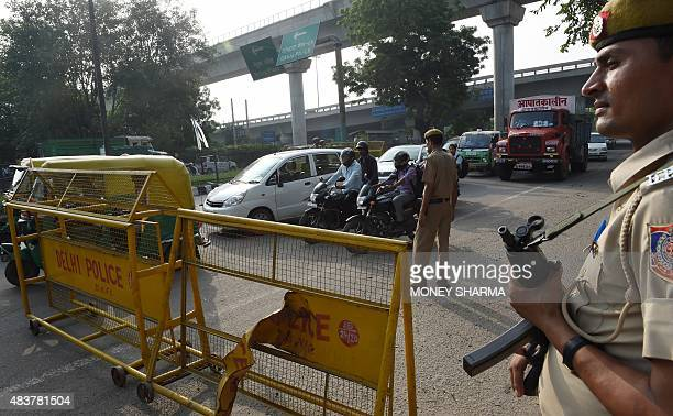 A Delhi police personnel stands guard at a barricade on a road ahead of the country's Independence Day celebrations in New Delhi on August 13 2015...