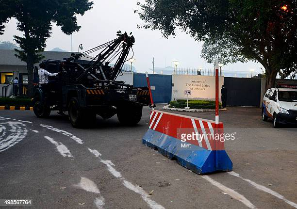 Delhi Police removing barricades placed outside the US embassy in Delhi as removal of the security barriers was one among a series of tough measures...