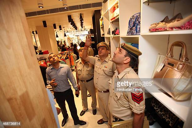Delhi Police searching for hidden cameras inside the changing rooms of a shopping mall at Civil Lines after Smriti IraniFabindia case on April 6 2015...