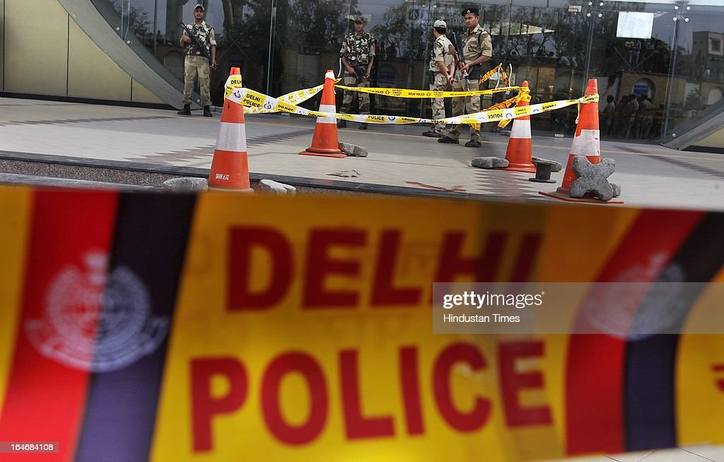 Delhi police team on the spot and carrying out preliminary investigations after a man opened fire at 28 year old Nidhi and her father Bhishan singh(58) outside the karkardooma Metro station, on March 26, 2013 in New Delhi, India. Nidhi died on spot.