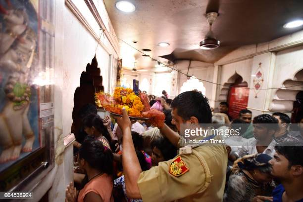 Delhi Policeman holds religious offerings at Kalkaji Mandir on Asthami the eighth day of the festival of Navratri at Kalkaji Mandir on April 4 2017...