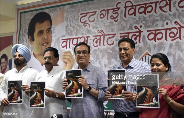 Delhi Pradesh Congress Committee President Ajay Maken with other leaders releases the Delhi Congress manifesto on Urban Infrastructure fifth in the...