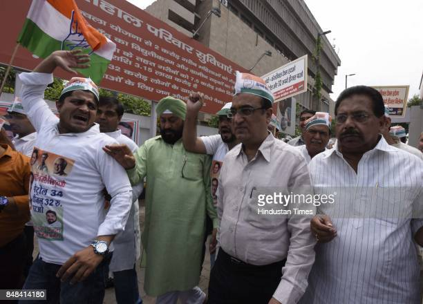 Delhi Pradesh Congress Committee President Ajay Maken with party workers start a signature campaign to protest against the unprecedented hike in the...