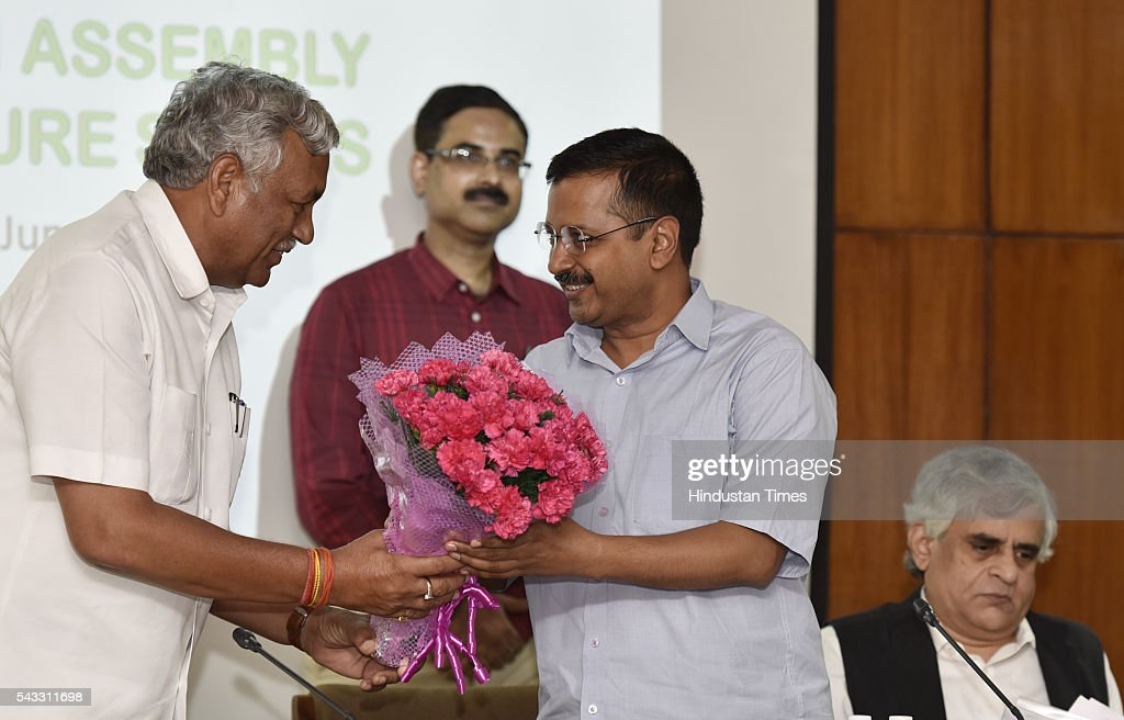 Delhi Vidhan Sabha Speaker Ram Niwas Goel felicitates Delhi Chief Minister Arvind Kejriwal as Ramon Magsaysay Awardee and senior journalist P Sainath looks on during a lecture on Water and farm crisis at Old Secretariat on June 27, 2016 in New Delhi, India.