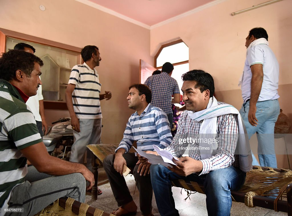 Delhi water Minister Kapil Misra with Senior Delhi Jal Board team and local AAP MLA Gulab Singh meeting with residents of Ghumenhera village on May 27, 2016 in New Delhi, India. There were reports in media that people are migrating from this village due to water crisis.