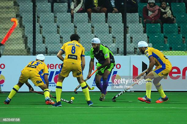 Delhi Waverider Player Singh Talwinder in action against the Jaypee Punjab Warrior Players during a match 10 of Hero Hockey India League between...