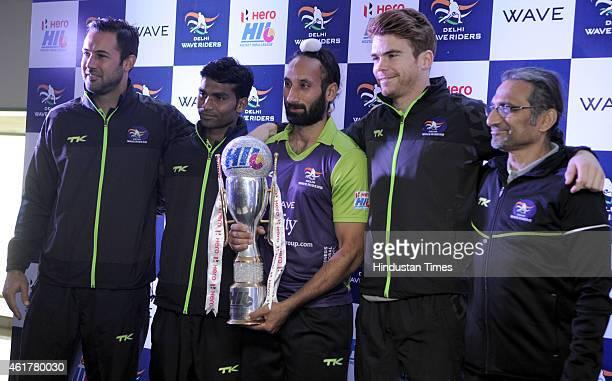 Delhi Waveriders captain Sardar Singh chief coach Cedric D Souza and team players Ram Diwakar Hayward Andrew and Pieterse Erasmus hold Hockey India...