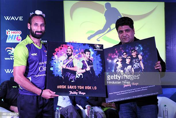 Delhi Waveriders' captain Sardar Singh holds Hockey India league 2015 Trophy during a press conference for Hockey India League 2015 at National...