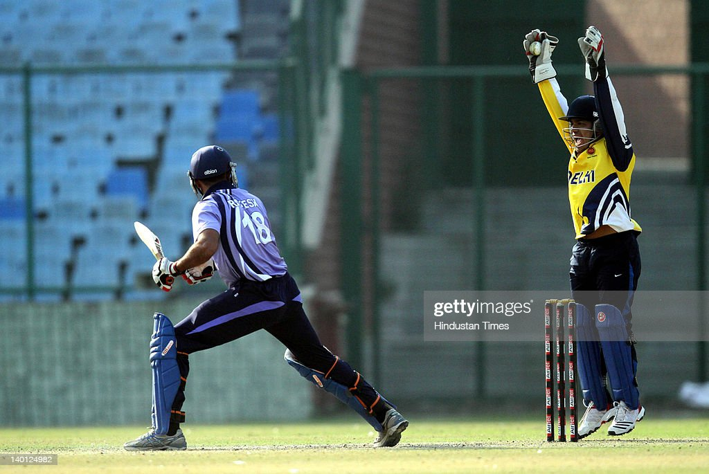 Delhi wicket keeper Punit Bisht catches out Services batsman Rajesh Kumar during the Vijay Hazare Trophy one day match between Delhi and Services at Ferozshah Kotla Ground on February 28, 2012 in New Delhi, India. Chasing a target of 275 set by Delhi, Services team was all out for 213.