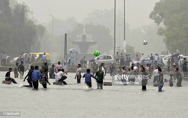 Delhiites enjoy first monsoon shower on June 16 2013 in New Delhi India The national capital has been witnessing premonsoon showers recording 61 mm...