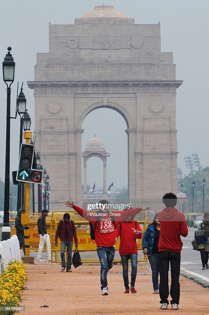 Delhites and tourist walks on Rajpath during the cloudy and pleasant weather on February 16, 2013 in New Delhi, India. The National capital witnessed a total of 18.6 mm of rains since yesterday and the weather is likely to remain cloudy for another day.