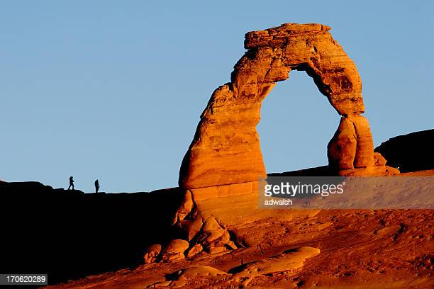 Delicate Arch & Hikers at Sunrise