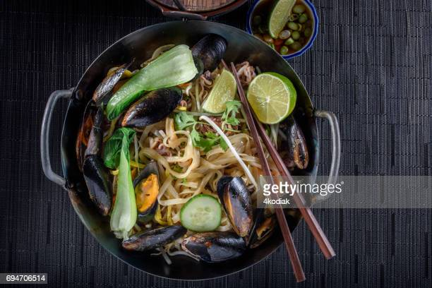 Delicious Asian Noodle with Bean Sprout , Mussel and Vegetables