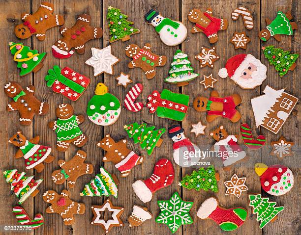Delicious beautiful Christmas gingerbread cookies on wooden table.
