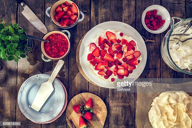 Delicious Berry Pavlova Cake with Strawberries and Raspberries