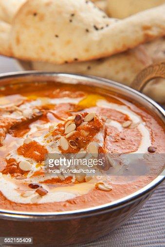 Delicious chicken curry with tandoori rotis