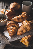 Delicious croissants for breakfast on wodd background