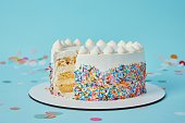 Delicious cut cake cut on blue background