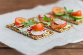 delicious diet sandwiches with cottage cheese with herbs and vegetables ,close-up,selective focus