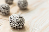 Sweet energy bites with cocoa and walnuts