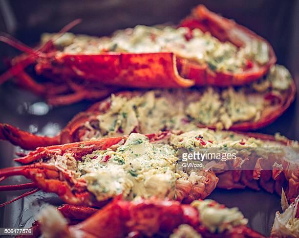 Deliziosi cucinati fresche e aragosta alla griglia