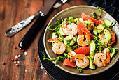 Delicious fresh salad with prawns, grapefruit, avocado, cucumber and herbs