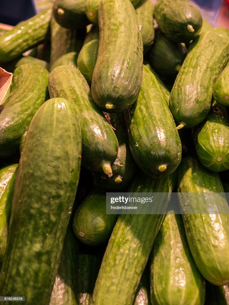 Delicious Green Cucumbers on a Market : Stock-Foto