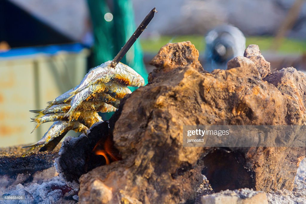 delicious grilled sardines on typical coals of the Sunshine Coas : Stock Photo