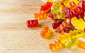 Curly gummies on a wooden table