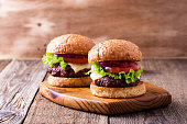 Delicious hamburger with lettuce, cheese, tomato, red onion and tomato sauce