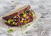 Delicious healthy vegetarian open cole slaw and a chickpea sandwich. On  light wooden rustic background