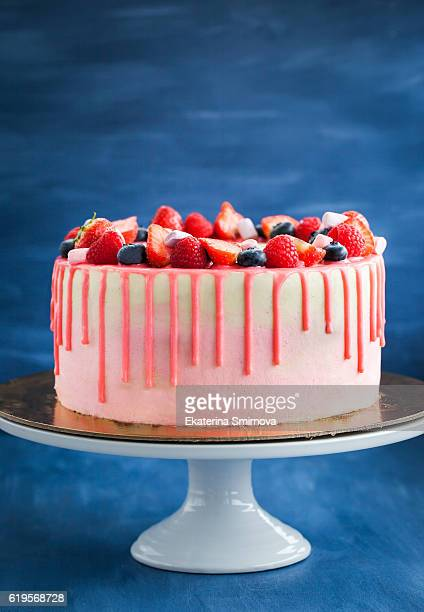 Delicious homemade pink cake decorated with fresh berries