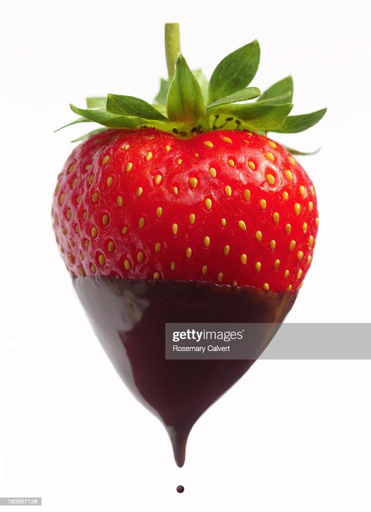 Delicious ripe strawberry dipped in dark chocolate
